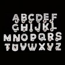 Nyelvpiercing acélból - cirkonköves betű