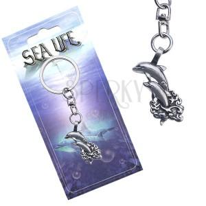 Fényes kulcstartó, két delfin a hullámok fölé ugorva