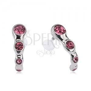 Piercing tragusba, acél, rózsaszín kövek