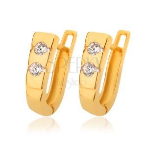 Fülbevaló 14K sárga aranyból - a vésetekbe beültetett két átlátszó cirkónia