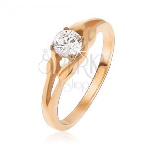 Arany színű gyűrű acélból, cirkónia az elipszis közepén