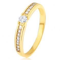 Arany gyűrű - kerek cirkóniával a közepén, a szárain vékony köves sávval