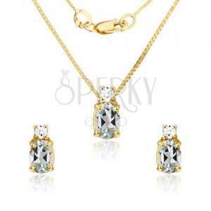 Arany szett - fülbevaló és medál, ovális kék topáz, átlátszó cirkóniák