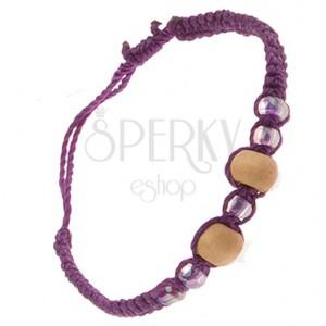 Lila színű zsinóros karkötő, bézs színű fa golyók, gyöngyök