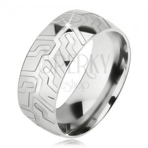 Ezüst színű acél gyűrű, járműgumi lenyomat