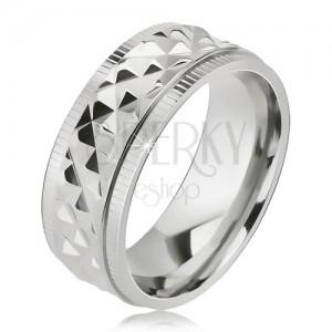 Fényes acél gyűrű, rombuszos minta, bevágások a szélein