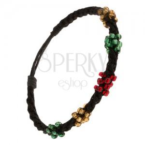 Csavart karkötő fekete zsinórokból, háromszínű gyöngy