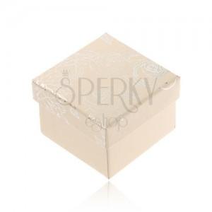 Krémfehér doboz ékszerre, ezüst színű virág motívum