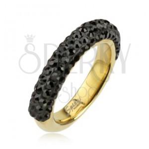 Acél gyűrű, aranyozott színben, fekete cirkóniákkal díszítve
