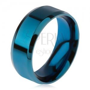 Fényes, acél gyűrű, kék színben, lemetszett szélek