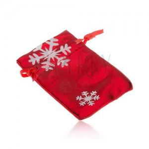 Ajándéktasak piros színben, fehér hópelyhek