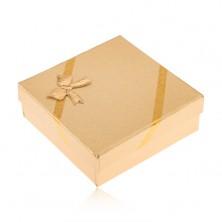 Ajándékdobozka arany színben ékszerre, szövött minta, masni