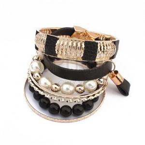 Multikarkötő - fekete és átlátszó gyöngyök, bőr sáv, arany színű karikák