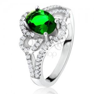 Ezüst gyűrű, ferde, ovális, zöld cirkónia, lekerekített vonalak, átlátszó kövek