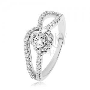 925 ezüst gyűrű, díszített lekerekített szárak, kerek átlátszó cirkónia, recézet
