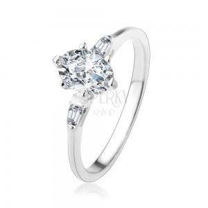 925 ezüst gyűrű, ovális átlátszó cirkónia, kicsi cirkóniás trapézok