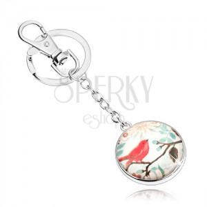 Cabochon kulcstartó, kör üveggel, piros madár leveles ágon, virágok
