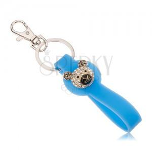 Kulcstartó ezüst színben, kék szilikon medál, medvefej, cirkóniák