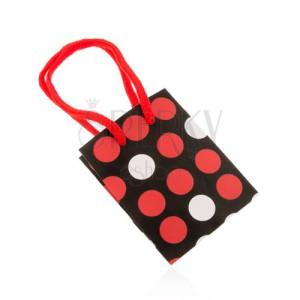 Ajándéktáska papírból fekete alap, fehér és piros pontok, zsinórok