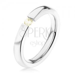 Acél gyűrű, ezüst szín, fényes szárak, apró világossárga cirkónia