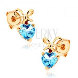 Fülbevaló 14K sárga aranyból - kék topáz szív megkötött masnival