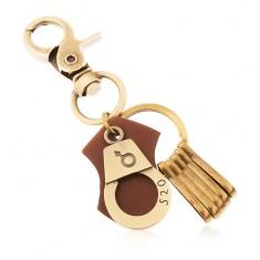 Kulcstartó sárgaréz árnyalatban, bilincs kivésett számmal és férfi szimbólummal