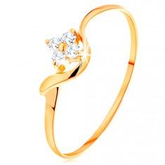 14K sárga arany gyűrű - átlátszó cirkóniás virág, hullámos szár