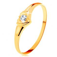 585 arany gyűrű - fénylő szívecske cirkóniával a közepén