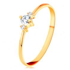 14K sárga arany gyűrű vékony szárakkal, három csillogó cirkónia