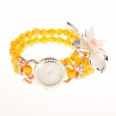 Karóra átlátszó narancssárga gyöngyökből, számlap cirkóniákkal, nagy méretű virág
