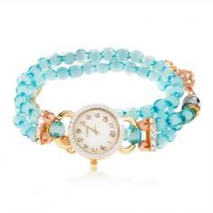 Óra karkötővel átlátszó, kék gyöngyökből, számlap cirkóniákkal