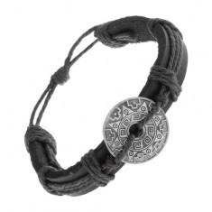 Karkötő fekete műbőrből és zsinórokból, kör mintákkal és kivágással
