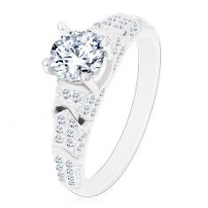 925 ezüst gyűrű, kerek cirkónia átlátszó változatban, csillogó szárak, ívek