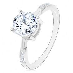 925 ezüst gyűrű, kerek cirkónia átlátszó színben, cirkóniák a szárakon