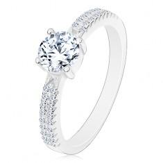 925 ezüst gyűrű, kerek átlátszó cirkónia foglalatban, cirkóniák a szárakon