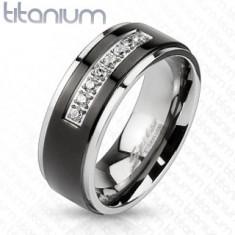 Titánium gyűrű ezüst színben, fekete sáv, fényes szélek, átlátszó cirkóniás vonal