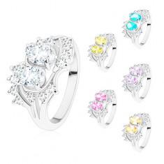 Gyűrű ezüst színben, hajlított szárvégek, csillogó átlátszó és színes cirkóniák