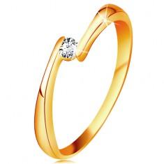 Gyűrű sárga 14K aranyból - átlátszó gyémánt a szűkített szárvégek között