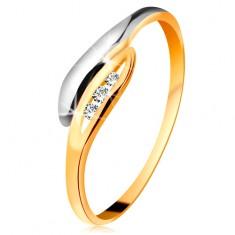 585 arany gyémánt gyűrű - kétszínű hajlított levelek, három átlátszó brilliáns