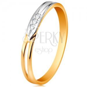 Gyűrű 14K aranyból, kétszínű szárak kivágással és három átlátszó cirkóniával