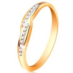 Gyűrű sárga 14K aranyból, szélesedő szárvégek beültetett cirkóniákkal