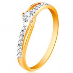 585 arany gyűrű osztott kétszínű szárakkal, átlátszó cirkóniák