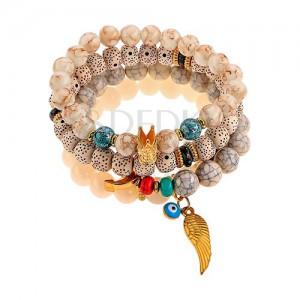 ba8172e1e0 Multikarkötő fehér, szürke és barna színű gyöngyökből, különböző medálok