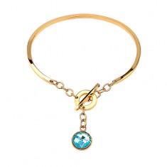 Acél karkötő arany színben, nem teljes ovális függő kék cirkóniával