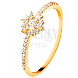 Gyűrű 9K sárga aranyból - csillogó virág átlátszó cirkóniákból, ragyogó szárak