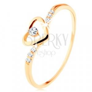 375 arany gyűrű, szívkörvonal átlátszó cirkóniákkal, díszített szárak