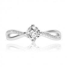 925 ezüst gyűrű, hullámos egymást keresztező szárak, átlátszó cirkónia