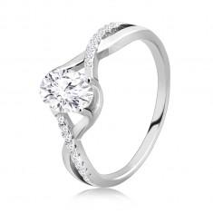925 Ezüst eljegyzési gyűrű - az ovális átlátszó cirkónia, a hullámok metszetében ül.