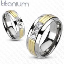 Titánium gyűrű - arany színű középső sáv, áttetsző cirkóniák